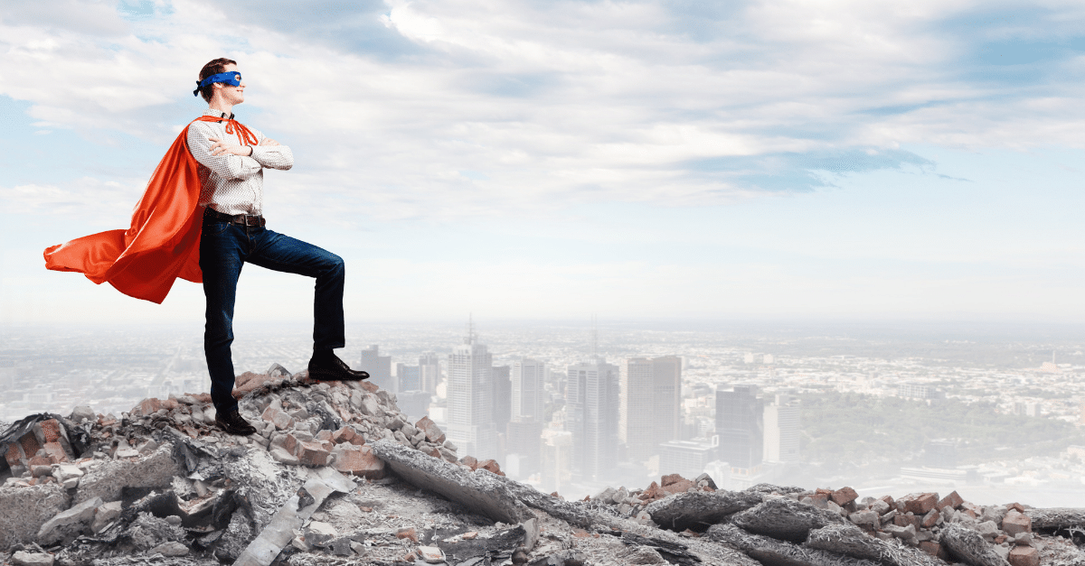 superhero standing over a city showing courage in leadership
