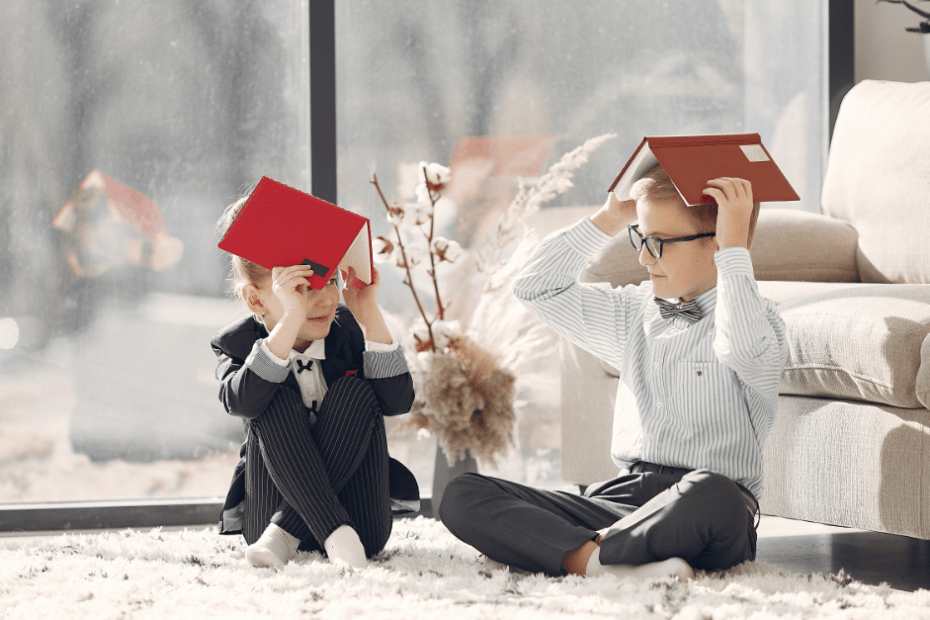 two kids working from home and playing with planners